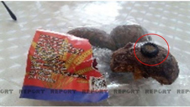 Bakıda uşağın yediyi şirniyyatın içərisindən qayka çıxdı - FOTO