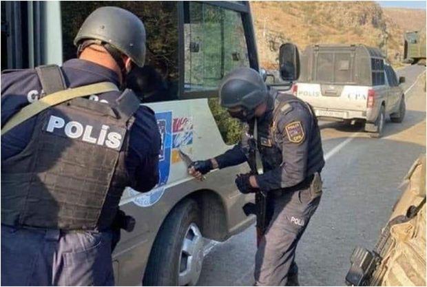 """Qondarma rejimin """"bayrağ""""ını silən polis kimdir? -  FOTO/VİDEO"""