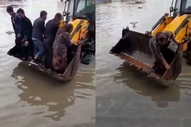 """Paytaxtın yağış suları basan küçələrindən sakinləri keçirən """"yeni texnologiyası"""" -  VİDEO"""