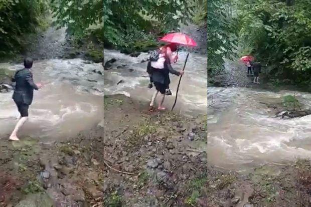 Azərbaycanda ata övladını məktəbə belində aparır - VİDEO